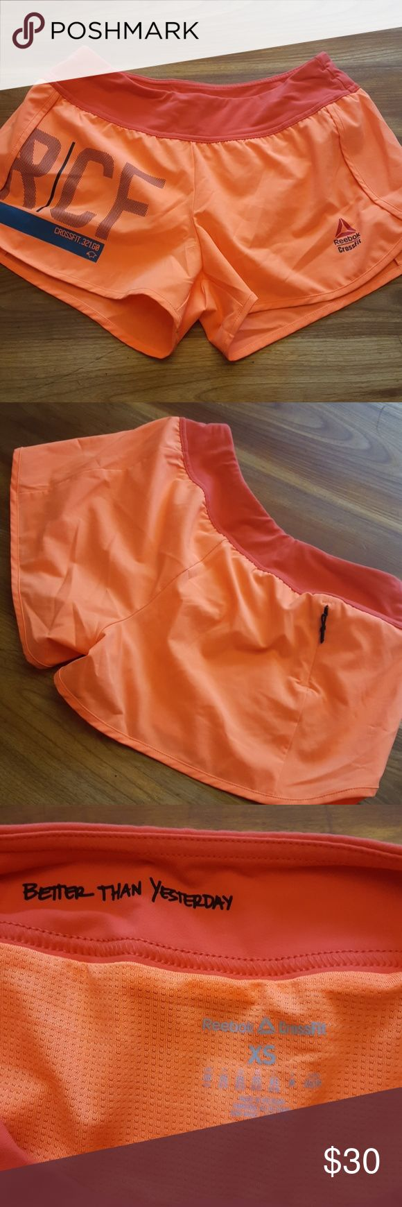 Reebok Crossfit Shorts NWOT Reebok crossfit shorts. Sized XS and orange in color.  Lined shorts with small zippered pocket in back Reebok Shorts