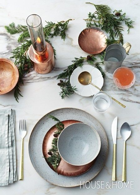 Beautiful holiday table setting with hammered copper plates and gold accents / stylist Nikole Herriott, photographer Michael Graydon