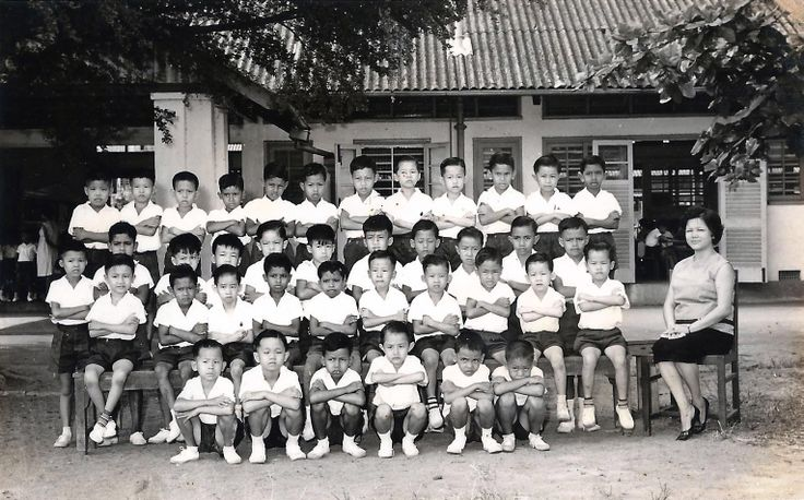 Primary One in Geylang English School with form teacher Mrs Wee.