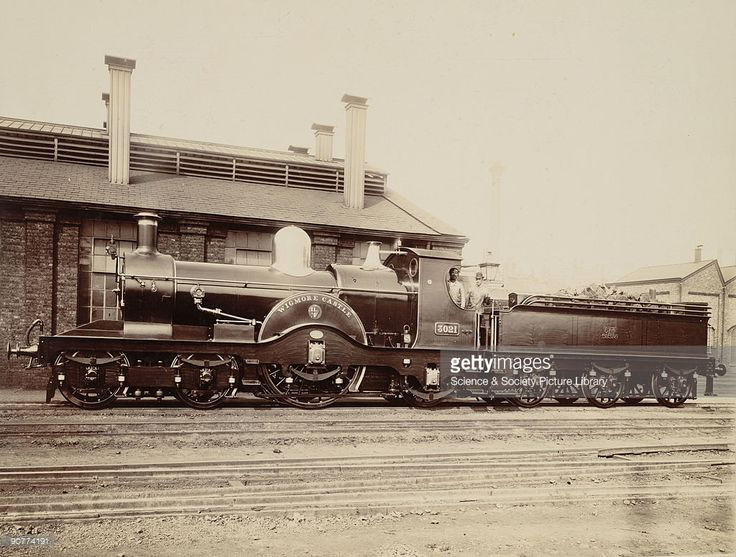 3021 'Wigmore Castle', with its driver and fireman, about 1870. This Broad Gauge locomotive was owned by the Great Western Railway. However, at this time the GWR were starting to convert to use both standard and broad gauge trains at this time, as it was difficult for standard gauge trains to connect to the GWR. Broad gauge trains were scrapped in favour of standard gauge trains in 1892.
