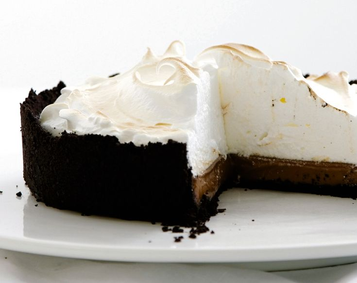 Chocolate and meringue black-bottom pie. A gorgeous presentation, perfect for the holidays. Chocolate cookie crust, glorious velvet cream and topped with a mountain of caramelized meringue. Make this one for sure!