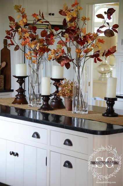 Rustic Fall Tabletop or Kitchen Island Vignette ~ How pretty this looks! I would never have thought to just put the leaf stalks in a clear glass vase.: