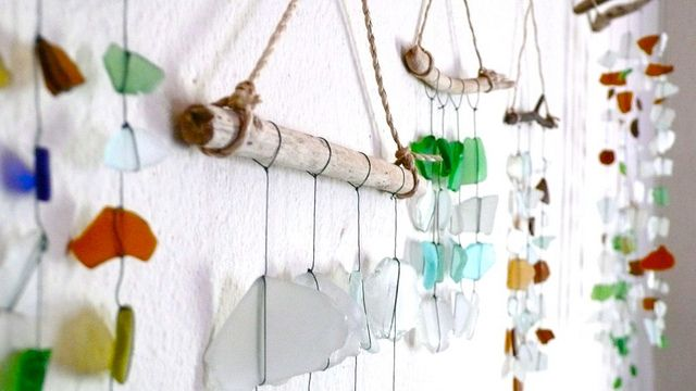 When you've collected some natural treasures, one simple option is to transform them into a  mobile.    Materials Needed:  One relatively thick stick  Rocks, recycled glass, pottery shards, leaves, pine cones, or other interesting found objects  2' of thick string or thin rope  Wire
