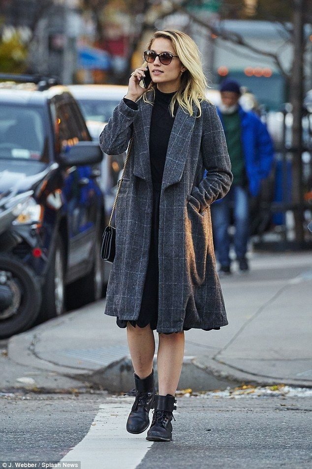 Change of season: Dianna Agron has put away her pretty flowery dresses in favour of a cosy, grey and white checked coat over a black dress and black ankle booties as she strolled in the East Village on Friday