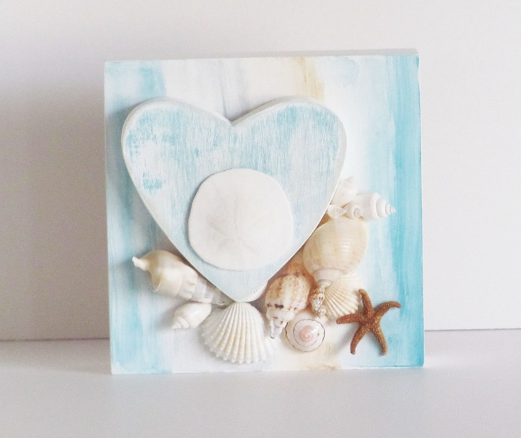 seashell art, wall decor, coastal living decor, sheshell hearts, seashell wall decor, beach cottage decor. $10.50, via Etsy.