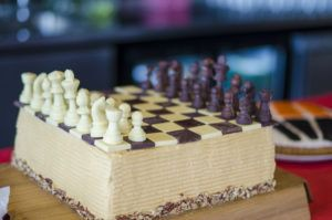 Full Size Chess Board Cake, Theree layer Chocolate with Salter Caramel Swiss Meringue Buttercream and Chocolate Chess Pieces!