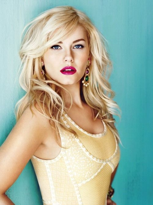 Elisha Cuthbert, she is so funny on Happy Endings