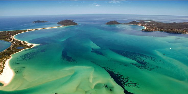 Port Stephens Australia - on the northern shore (left) is Hawks Nest and Tea Gardens with Yacaaba headland, and Broughton Island beyond. Shoal Bay and Nelson Bay are on the southern shore with Tomaree headland.