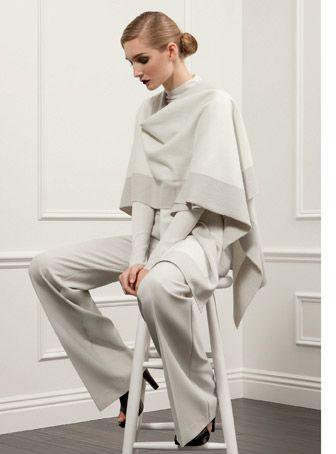 White cape, subtle color blocking.