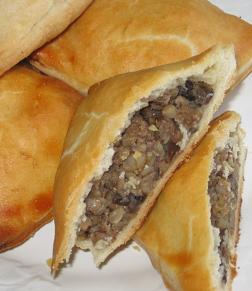 Jewish buckwheat-mushroom knishes recipe is made with a flaky cream cheese pastry dough and filled with kasha, mushrooms and onions.