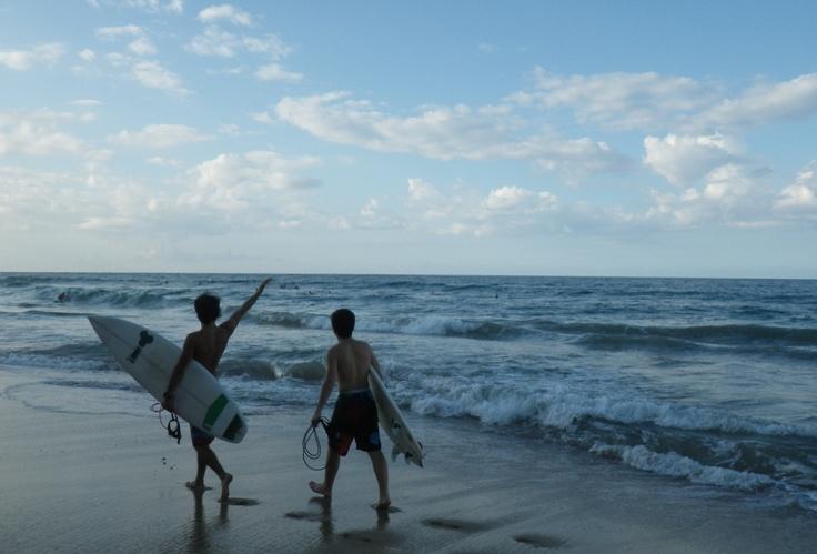 Surfers walking to meet their friends - waving hello at Ocean Park Beach