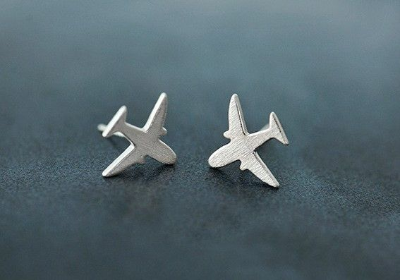 Looking for travel inspiration in the form of understated elegance? These tiny sterling silver airplane earrings fit the bill! Thoughts of adventure are always between your ears, so why not put though