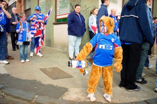 Stock Photo : Young football fan in fancy dress costume