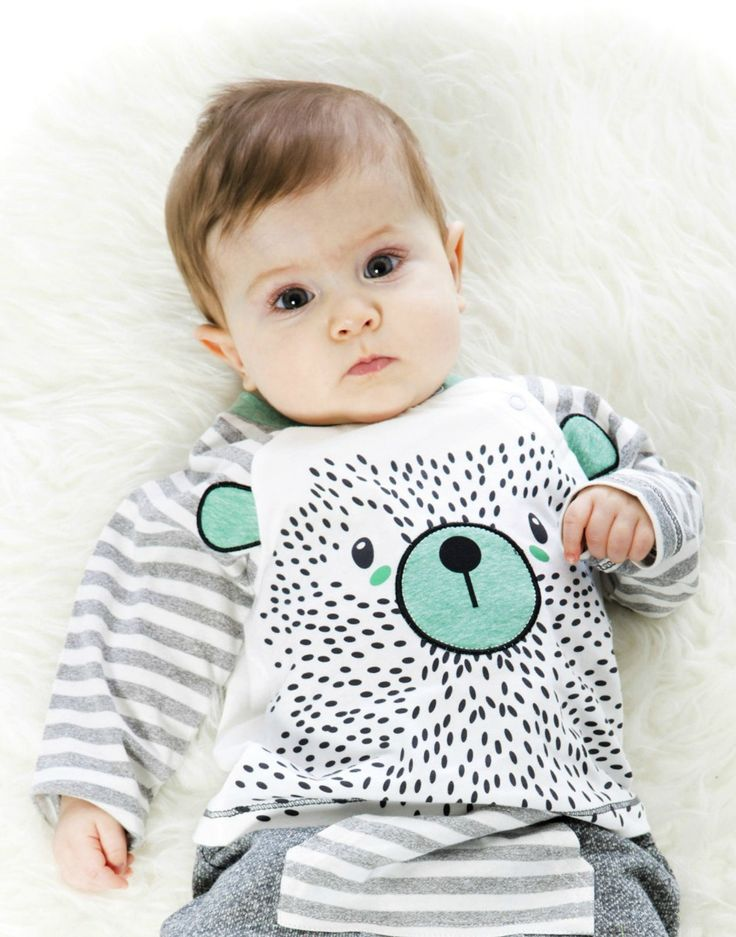A whimsical print adds playful charm to the Bear Print T-Shirt for boys. This long sleeve soft cotton tee features contrast striped raglan sleeves, a large front graphic print, and a crew neckline with a contrast ringer.