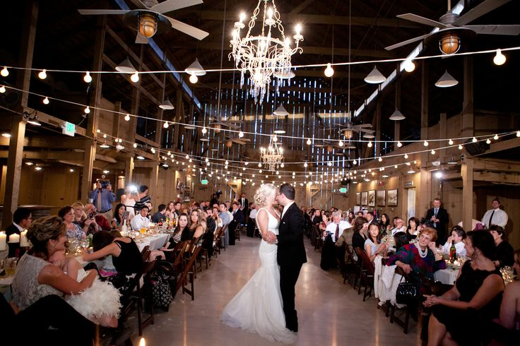 barn wedding, iron chandeliers, string lighting, fruitwood folding chairs, Camarillo Ranch, www.partypleasers.com