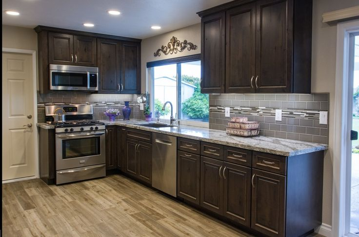 can i put laminate flooring over hardwood with images laying laminate flooring installing on kitchen remodel floor id=63640