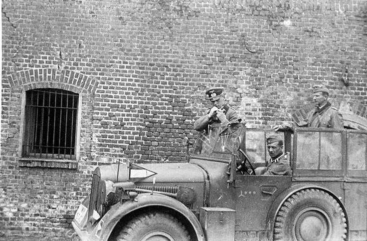 Rommel in France, before he was a Field Marshal. If you look at the fender of the Horch you will see a Division Commander's pennant.