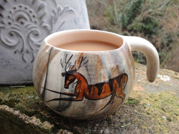 I'm supping from my Upper Palaeolithic art mug. St Catherine's charity shop: 50p.