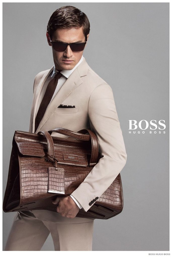 Hugo Boss men's brown leather bag, nice design, nice nature leather pattern, mix modern and formal look. Also, it matches the dark blue suit, the dark brown belt & shoes.