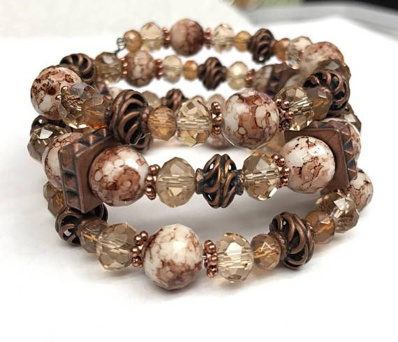 Gorgeous Bronze detailed brackets combined with Taupe crystals, multi color glass beads. Memory wire bracelet that wraps around your wrist. Handmade by Josefina and ready to ship. Fits Medium wrist. Also see similar sister listing: