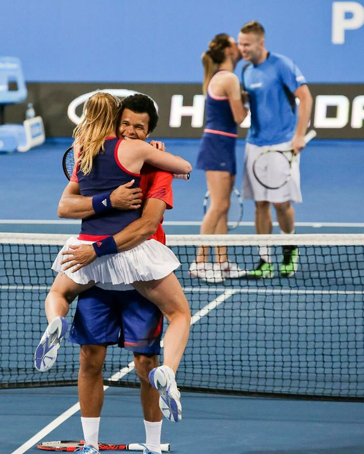 Alize Cornet jumps into Jo-Wilfried Tsonga arms after they win France's first Hopman Cup.