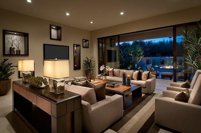 Living room sofa table flowers design coverlet lighting large room idea TV