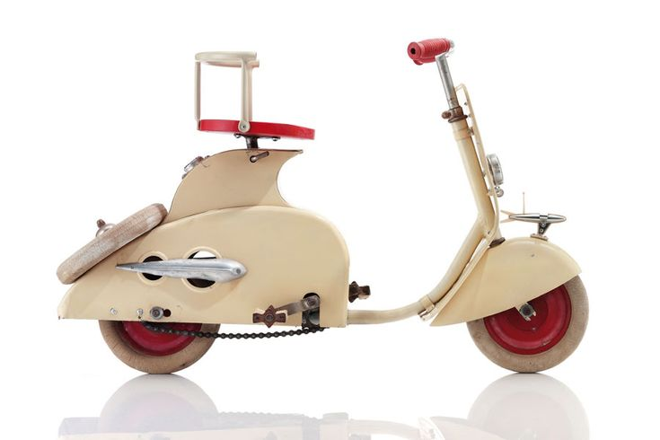 "Produced by French toymaker MFA (Manufacture Française d'Ameublement) around 1960, this bicycle was designed to look like a motor scooter. The children who pumped the pedals of the MFA bike nicknamed it the ""Lambretta"" or ""Vespa,"" after the toy's high-powered, adult-size counterparts. [photo by Bernhard Angerer]"