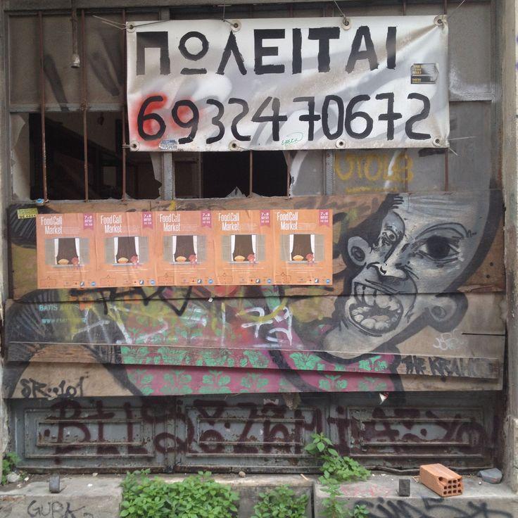 Monastiraki street, For Sale sign & graffiti. Photo by Alexia Amvrazi.