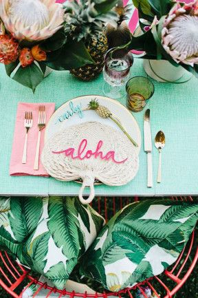 Cute tropical table setting with Pineapples and Proteas. Pretty pinks and cool greens - 100 layer cake blog