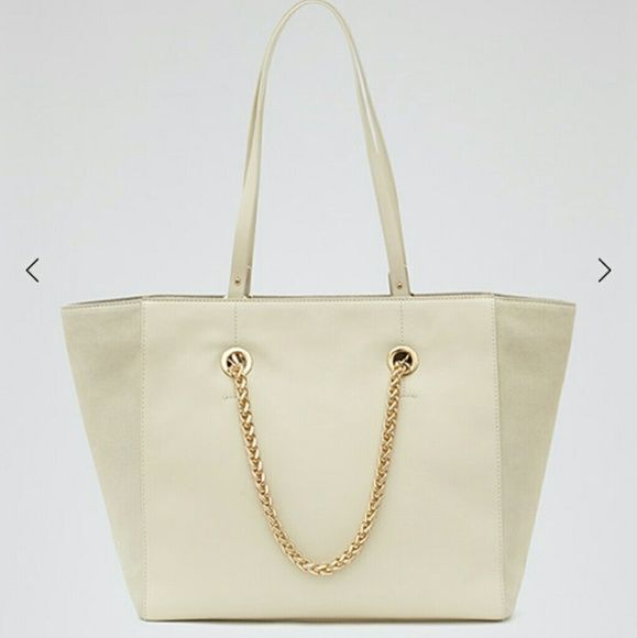 REISS | Cherry Cream Leather Gold Chain Tote Bag Reiss luxurious leather and suede block tote bag. Fully lined with pocket compartments, two handles and a detachable coin/clutch purse makes this the all-equipped summer carryall! Accents of gold hardware and gold chain on both sides add the perfect chic touch. 100% leather,  REISS dustbag and original tags included as well. Rare REISS purse, hard to find! If you want more pictures, please let me know ♥ Reiss Bags