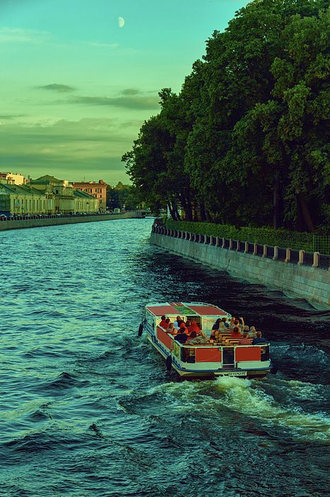 Boat trips along the numerous rivers and canals of the evening St. Petersburg by George Westermak,  Saint Petersburg is the northernmost city in the world with a population of over one million people. This is one of the most important Russia tourist destinations. #George Westermak#travel#FineArtPrints#landscape#Photography