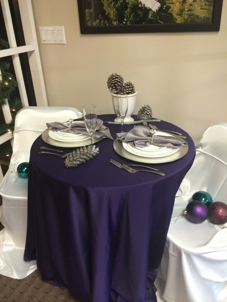 Elegant purple and silver pacesetting and tablescape! Love the silver acorns.  From Big Top Tent Rentals