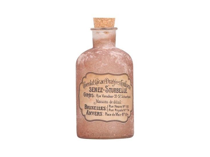 fraai bewerkte oud roze stolpfles met nostalgisch etiket L