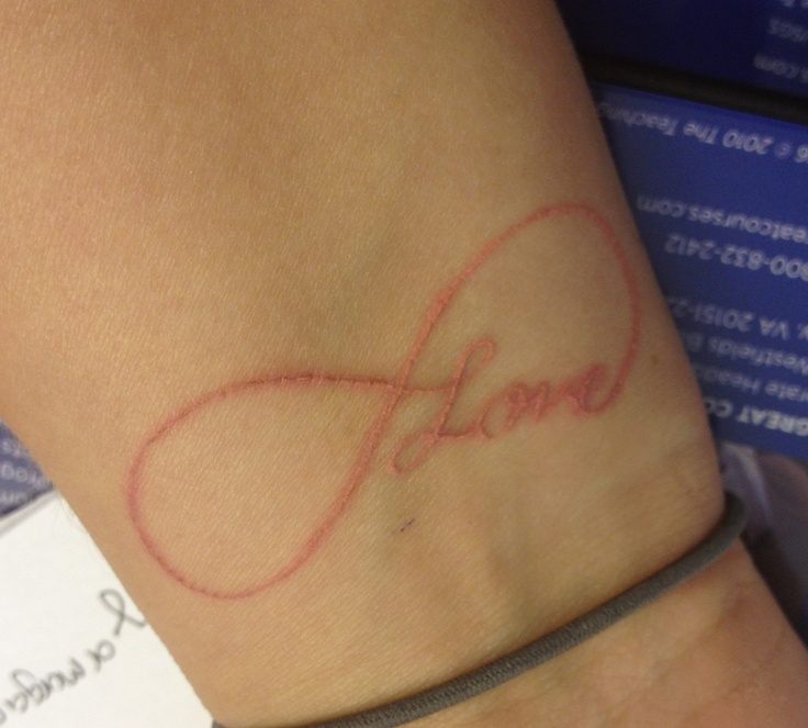 Love infinity pale pink tattoo I have this on my right wrist and love it