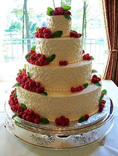 Simple-but-classy buttercream scroll tiered wedding cake, garnished with fresh (and might I say, YUMMY!) raspberries and mint leaves.