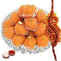 Send A Free Decorative Rakhi, Roli, Tilak and Chawal with Haldiram Pure Ghee Ladoo to India Rs. 495 / $ 8.25