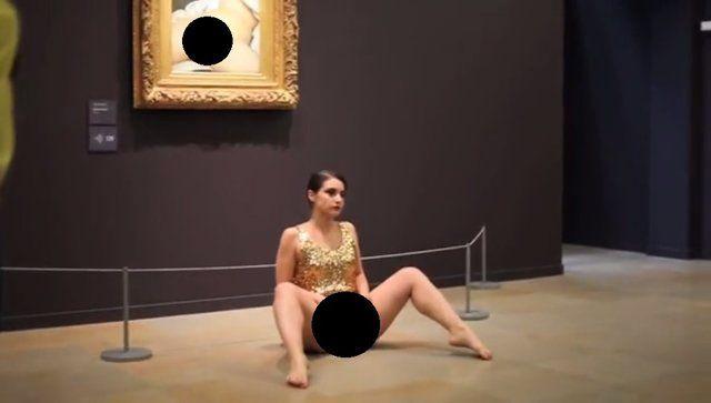 """De Robertis entered the room in a gold sequin dress and proceeded to expose her own """"L'Origine du monde"""" to a crowd of unsuspecting security guards and applauding gallery goers. The artist was eventually taken away by police and, as Artnet reports, the museum and two of its guards subsequently filed sexual exhibitionism complaints against the bold woman."""