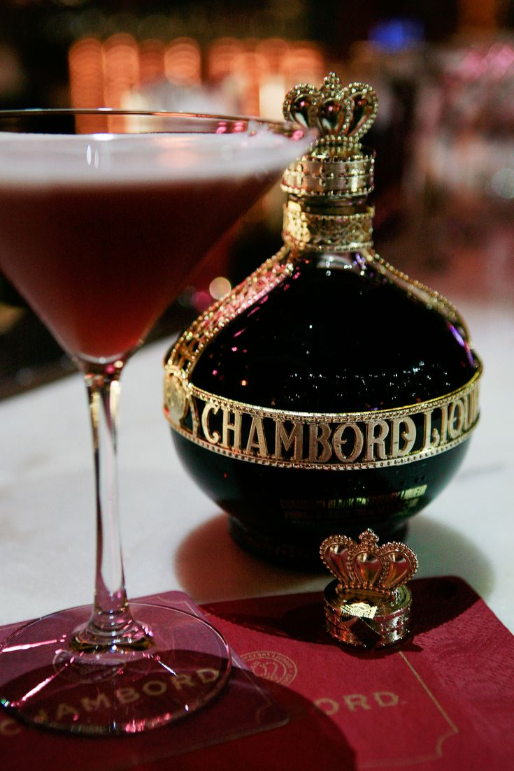 French Martini: 1 1/2 oz vodka, 1/2 oz Chambord Liqueur, 3 oz pineapple juice. Shake with ice, strain and garnish with blackberry skewer.