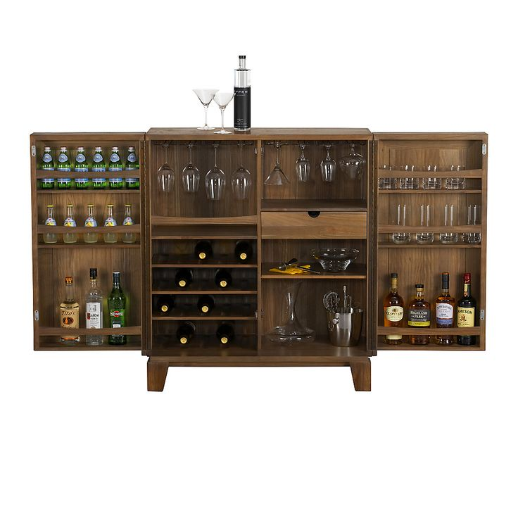 Serve your guests in style with a bar cabinet from Crate and Barrel. Bar carts and cabinets free up valuable space and are a beautiful addition to any room.