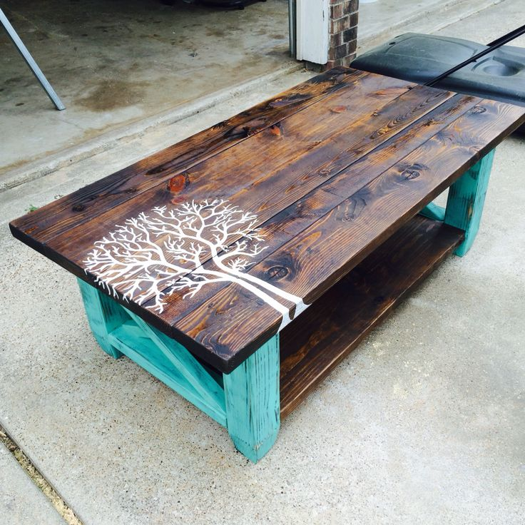 painted tree pallet coffee table with farm brand burnt in it instead of the tree