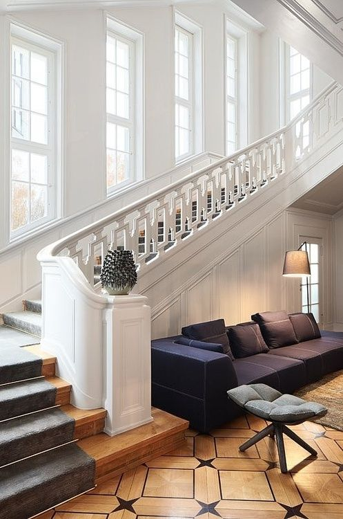 Das Stue Hotel Interior by Patricia Urquiola-beautiful stairway & floor with inlay balanced by the contemporary furniture & light