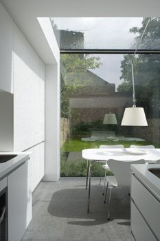 Paul Archer Design.  Too much white Formica, but this is just for the effect of the glimpse of green.