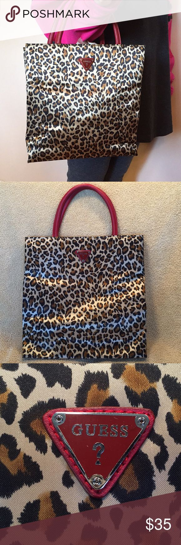 Authentic Guess leopard print bag 👜 Guess brand Size is about 11in x 11in Red accents Snap closure Flatter style bag Guess logo inside bag has some scratching Guess Bags