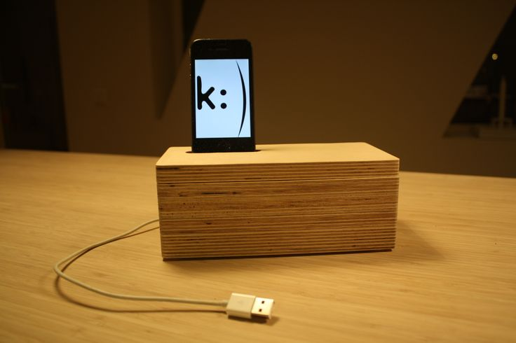 iPhone docking station with hidden storage inside.  Made of birch veneer.