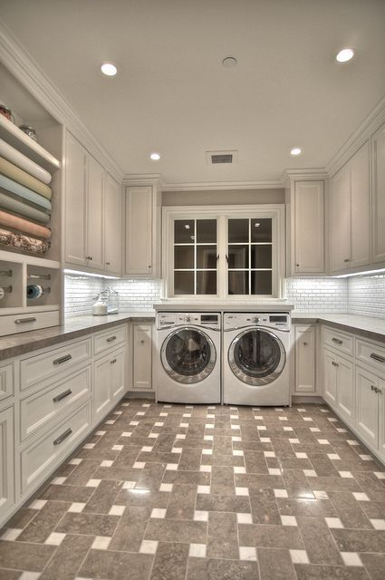 Big Laundry room with double counters and lots of cabinets. That patterned tile floor is so cool too!