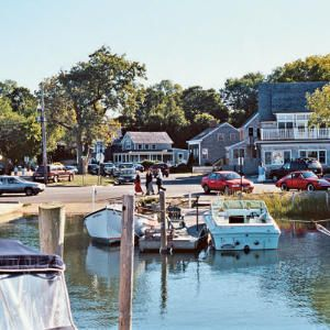 Hamptons Hide Away: Sag Harbor, New York - whaling captains' stately homes and a bustling wharf,  Sag Harbor feels more like a New England fishing village than part of the ritzy Hamptons. Residents of this New York village cherish its maritime past and close-knit community. Locals work together to preserve treasured vestiges of the past. Known as a retreat for writers such as James Fennimore Cooper and John Steinbeck, Sag Harbor remains a beacon for novelists and playwrights today.