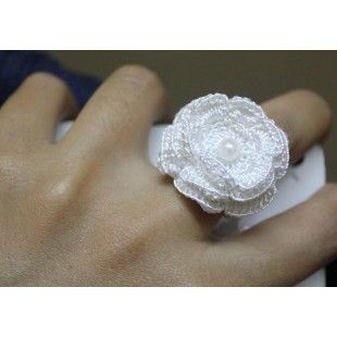 Dress up your fingers with this beautiful and delicate looking handmade ring.  A must have accessory for all you lovely ladies. Made of crochet white flower with a pearl that stands out on your finger. Band is stretchy so it will fit a number of sizes