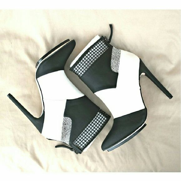 "GX by Gwen Stefani Kanayo booties in black/white. These sporty booties feature laser cut detail (feels like rubber) at the anckle, pointed toe and allover colorblocking. Colors: black and white. Back zip clouser.  Details: heel 4-3/4"", platform 1/2"", high arch, fits narrow - 1/2 size small, faux leather. GX by Gwen Stefani Shoes Ankle Boots & Booties"