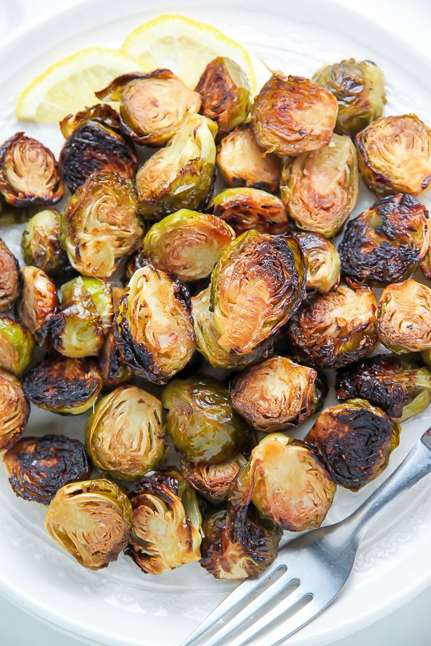 """Even veggie haters love these crunchy, flavorful brussels sprouts! When I was 19, I spent some time """"living"""" in Europe. I was young, working a crappy job, dating an even crappier dude, and figured ditching town was my chance to shake off some stagnant strings and explore the world! So like any sane minded young …"""