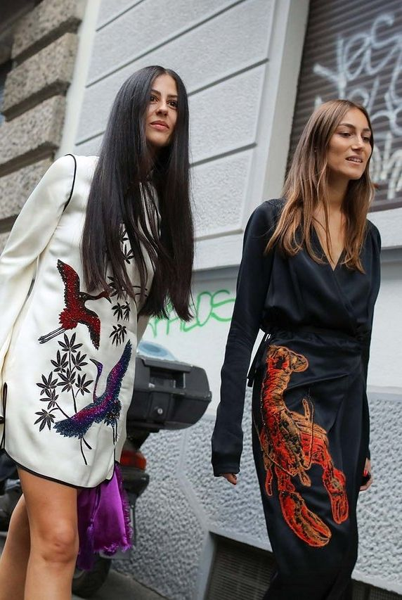 Gilda Ambrosio and Giorgia Tordini in Attico dresses spotted on the street at Milan Fashion Week. Photographed by Phil Oh.